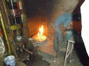 Re-heating of brass ingots prior to pressing at Raj Laxmi Industries